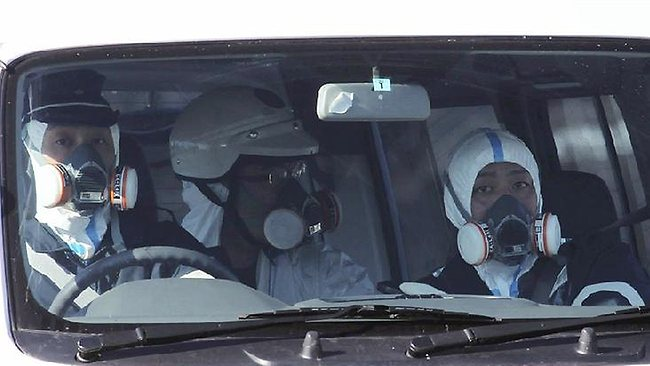 019909-japan-earthquake-gas-masks-near-fukushima-nuclear-plant.jpg